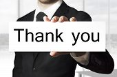 Businessman Holding Sign Thank You