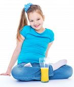 Young girl with glass of orange juice.