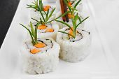 Japanese Cuisine - California Roll made of Salmon, Cream Cheese and Avocado inside. Served with wasa