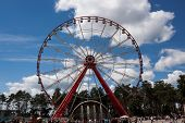 Ferris Wheel In Central Park Kharkov Against The Blue Sky With Clouds