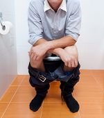 Businessman In Toilet