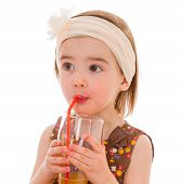 little girl with a glass of juice.