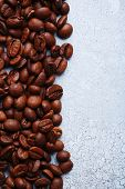 Coffee beans on color wooden background