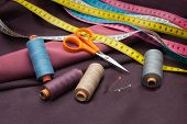 Thread Spools, Pin, Measuring Tapes And Scissors.