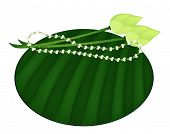 Lotus and Jasmine Garland on Green Banana Leaf