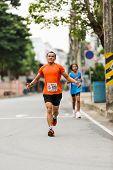 Running Athlete In Mini-marathon Race