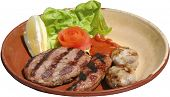 Succulent thick juicy portions of grilled sausages, steak and meat balls
