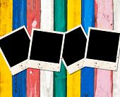 Blank Photos On Color Wooden Background