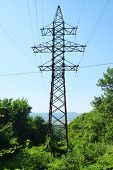Electric power transmission towers in the mountains