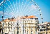 big ferris wheel against a blue sky in Marseilles
