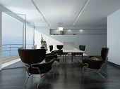 Modern office meeting room interior with stylish contemporary armchairs around a table, easel in the
