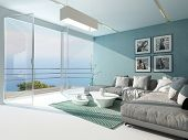 Luxury waterfront apartment living room with a floor-to-ceiling glass window overlooking the ocean with patio doors and an aquamarine accented side wall and carpet