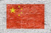 Flag Of China Painted Over Brick Wall
