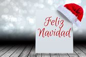Feliz navidad against santa hat on poster