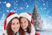 Mother and daughter against blurry christmas scene