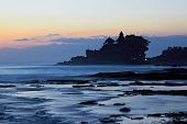 picture of tanah  - Tanah Lot Temple and ocean waves at sunset Bali Indonesia - JPG