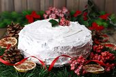stock photo of desert christmas  - Christmas cake with wreath on wooden background - JPG