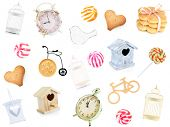 Decorative birdhouses, cage, birds, clocks, lantern, cookies and candies as background