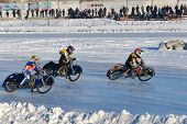 NOVOSIBIRSK, RUSSIA - DECEMBER 20, 2014: Unidentified bikers during the semi-final individual rides of Russian Ice Speedway Championship. The sports returns to the sport arenas after a decline