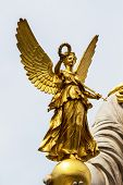 parliament in vienna, austria. seat of government. statue of pallas athena, goddess of weiheit.