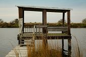 picture of bayou  - wooden boat dock with fishing pier and reeds - JPG