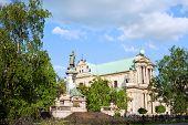 Carmelite Church And Adam Mickiewicz Statue In Warsaw