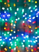Blurred Christmas Illumination On Window