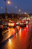 Urban Traffic In Rainy Evening