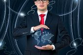 Young Businessman  Holding World Map