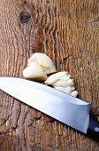 garlic cloves on wooden background