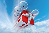 3D rendering of a giftbox flying held by a drone in the sky