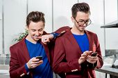 Business brothers twins with phones
