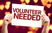 Volunteer Needed card with heart bokeh background