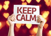 Keep Calm card with heart bokeh background