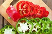 Sliced Colourful Paprika Peppers On The Table