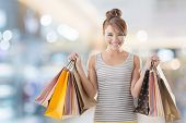 Shopping girl of Asian, closeup portrait isolated on white with clipping path.