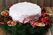 foto of desert christmas  - Christmas cake with wreath on wooden background - JPG