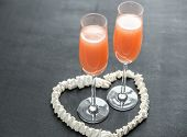Two Bellini Cocktails Inside Of Meringue Heart