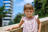 Portrait of a smiling little girl in summer day