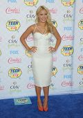 LOS ANGELES - AUG 10:  Emily Osment arrives to the Teen Choice Awards 2014  on August 10, 2014 in Los Angeles, CA.