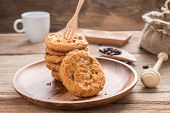Fork Put On Stacked Cookies And Wood Dish