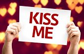 Kiss Me card with heart bokeh background