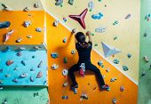 Girl Climbing Up On Wall Indoor