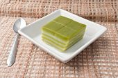 stock photo of chan  - Thai sweetmeat or Khanom Chan is a kind of sweet Thai dessert in white bowl on Fabric - JPG