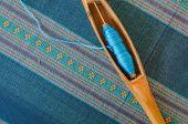 image of handloom  - Blue Cotton Insert A Shuttle on a fabric - JPG