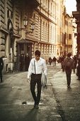 Handsome Young Man Walking In European City Street