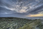 Sunset in the dunes of the island Terschelling in Netherlands