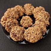 foto of baked raisin cookies  - oatmeal cookies with raisins on a plate on table - JPG