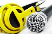 Microphone And Yellow Headphones