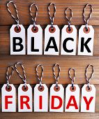 Black Friday text, Letters on labels on wooden background